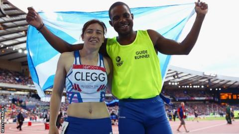 Gold medalists Libby Clegg of Scotland and her guide Mikail Huggins
