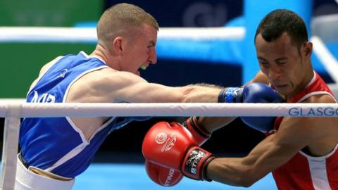 Paddy Barnes in action against Charles Keama in the men's light-flyweight quarter-final at the 2014 Commonwealth Games in Glasgow