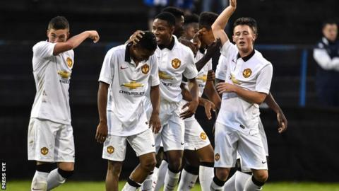 Cameron Borthwick-Jackson celebrates after scoring Manchester United's second goal