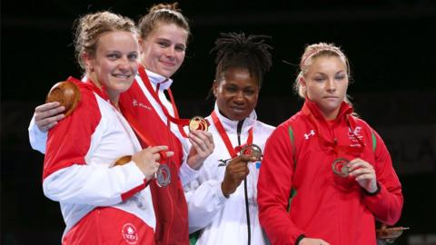 Middleweight Lauren Price (right) made history as the first Welsh female boxer to medal at the Commonwealth Games, securing bronze.