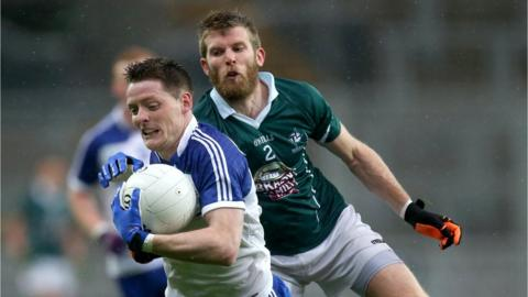 Conor McManus shields the ball from Ciaran Fitzpatrick as Monaghan run out two-point winners after extra-time