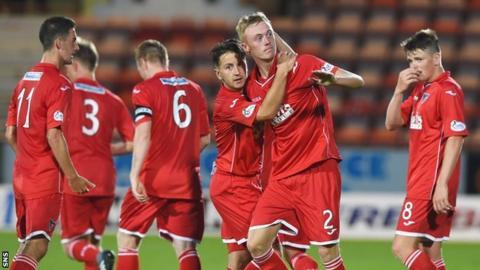 Ross Millen is congratulated on his winning goal