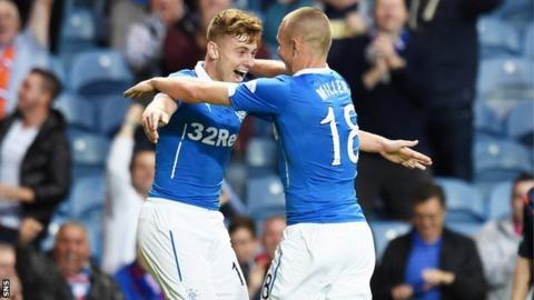 Kenny Miller congratulates the scorer of Rangers' first goal, Lewis Macleod