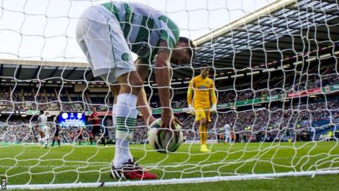 Mikel Lustig retrieves the ball as Celtic fall behind to Legia Warsaw