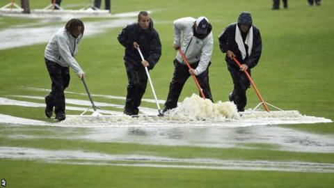 Ground workers clear water off the fairway during the second round at Valhalla