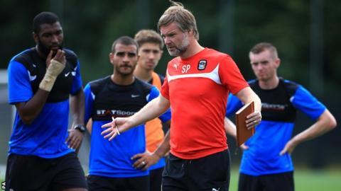 Coventry City manager Steven Pressley coaches the players