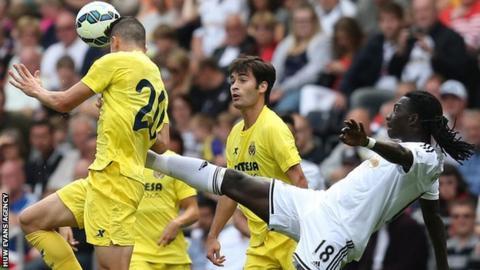 Gabriel Paulista beats Swansea's Bafetimbi Gomis to the ball