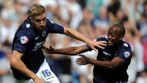 Millwall's Mark Beevers (left) is congratulated by Millwall's Nadjim Abdou