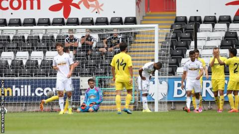 Swansea look ejected after conceding a goal against Villarreal