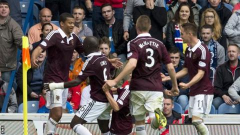 The Hearts players celebrate with goal scorer Osman Sow as his late goal earns the visitors victory over Rangers.