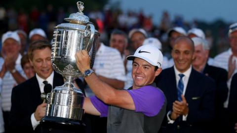 Rory McIlroy lifts the PGA Championship trophy