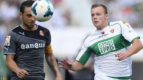 Charlie I'Anson (right) in action for Elche