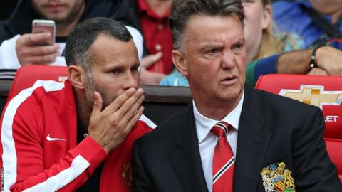 Former Wales captain Ryan Giggs, now Manchester United assistant manager, discusses tactics with manager Louis van Gaal during their game against Swansea City.