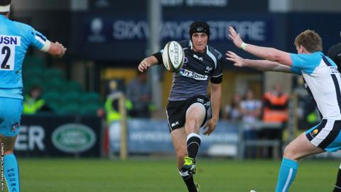 Ospreys fly-half Sam Davies chips the ball into space during his side's pre-season friendly defeat at Worcester.