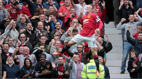 Wayne Rooney celebrates after bringing Manchester United level against Swansea City.