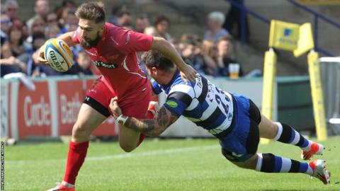 Jordan Williams is tackled by Luke Arscott in Scarlets' pre-season game against Bath, which finished in a 26-26 draw.