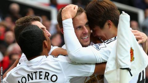 Swansea City players celebrate