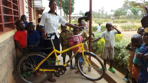 It takes Benitha Uwamariya an hour to cycle to school