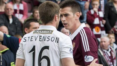 Lewis Stevenson and Jamie Walker clash at Tynecastle