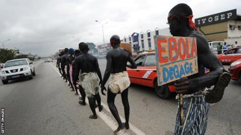 Members of the artist group ''Be Kok Spirit'' march to raise awareness on the Ebola virus