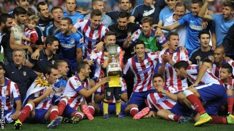 Atletico players celebrate their victory