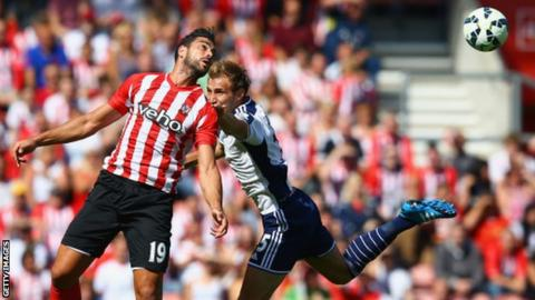 Graziano Pelle of Southampton and Craig Dawson of West Brom compete for the ball