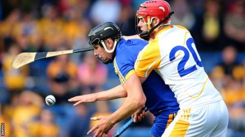 Clare's Alan O'Neill is challenged by Conor Burke of Antrim