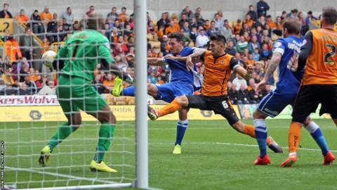 Defender Sean Morrison goes close for Cardiff City in their Championship game at Wolves.