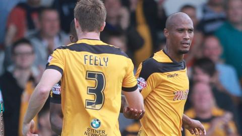 Striker Chris Zebroski scored as Newport County secured their first point of the League Two season at home to Burton Albion.
