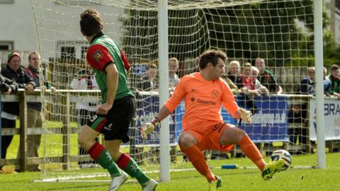 Glentoran striker Curtis Allen turns to celebrate after scoring for Glentoran against Ballinallard at Ferney Park