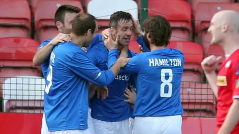 Midfielder Ciaran Martyn is congratulated after scoring one of his three goals against Cliftonville