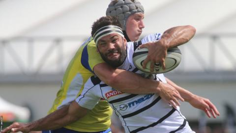 Jonathan Davies makes his Clermont Auvergne Top 14 debut in their win at Brive and is seen here tackling Arnaud Mignardi
