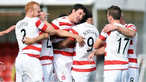 Jason Scotland is congratulated by Martin Canning after scoring Hamilton's fourth