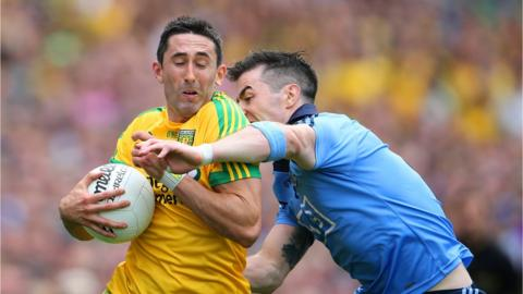 Rory Kavanagh and Michael Darragh Macauley contend for possession during Donegal's 3-14 to 0-17 victory at Croke Park