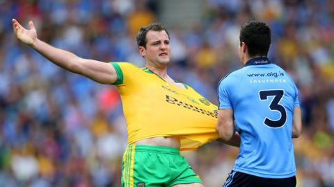 Donegal captain Michael Murphy has his shirt tugged by Rory O'Carroll of Dublin