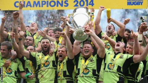 Northampton Saints captain Dylan Hartley and Tom Wood raise the trophy after their victory during the Aviva Premiership Final