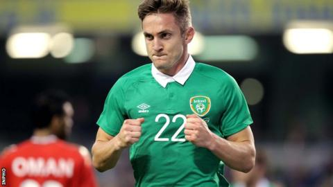 Kevin Doyle celebrates after scoring the opener against Oman