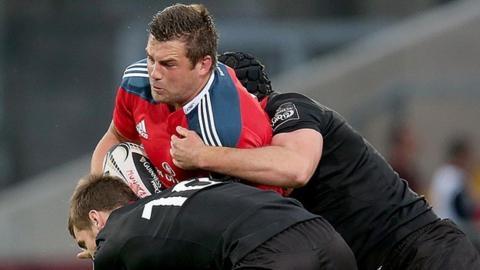 Munster try-scorer CJ Stander is tackled by Greig Tonks and Fraser McKenzie
