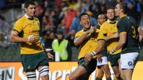 Australia's Israel Folau celebrates scoring