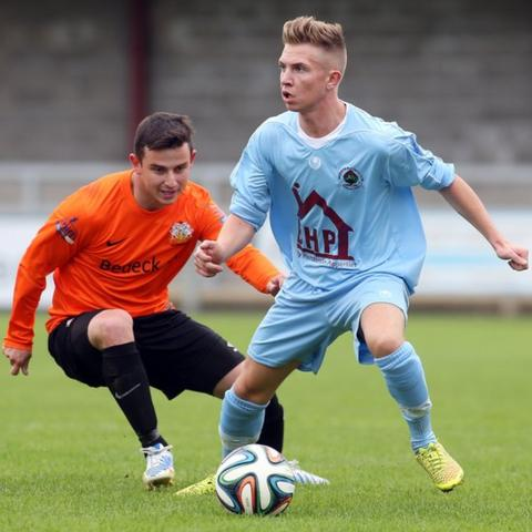 Glenavon midfielder Shane McCabe closes in on Institute opponent Matthew Young at Drumahoe