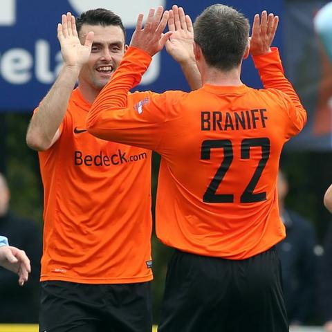 Eoin Bradley celebrates with Kevin Braniff after scoring in Glenavon's 4-1 win over Institute in the Irish Premiership