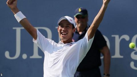 Kei Nishikori, of Japan, reacts after defeating Novak Djokovic