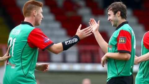 Kym Nelson and Fra McCaffrey celebrate Glentoran's 1-0 victory over Coleraine at the Oval