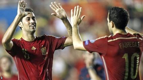 Sergio Busquets and Cesc Fabregas