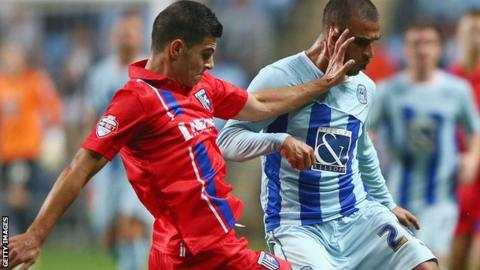 Gillingham's John Egan (left) and Coventry's Marcus Tudgay