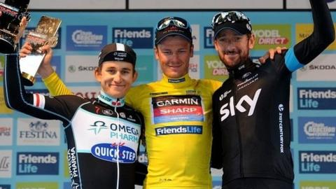 Dylan Van Baarle of Garmin-Sharp (centre) poses with second-placed Micha Kwiatkowskii of Omega Pharma-Quickstep (left) and third- placed Sir Bradley Wiggins of Team Sky (right)