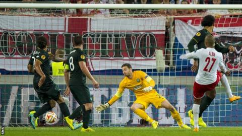 Celtic goalkeeper Craig Gordon makes a save to deny Salzburg's Alan
