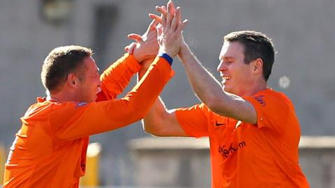 Glenavon defender Kris Lindsay congratulates Kevin Braniff after his goal gives Glenavon a 1-0 victory over Linfield
