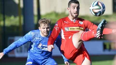 Fra Brennan closes in on Reds striker Joe Gormley, who put Cliftonville ahead in the 1-1 draw