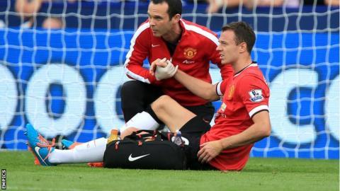Manchester United defender Jonny Evans receives treatment